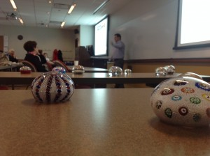 Paperweight display with Mitch teaching in the background