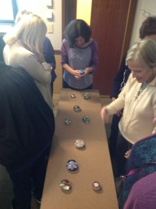 The students looking at antique paperweights