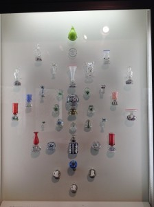 A display of paperweight related objects in the Rubloff collection