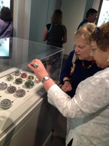 Evelyn and Rae enjoying a paperweight display