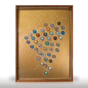 Lot 329 Forty-two paperweight buttons, mounted as a grape cluster and framed