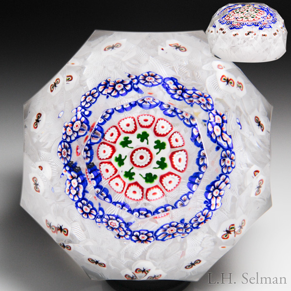 Rare Antique Baccarat concentric shamrock and butterfly millefiori on upset muslin faceted paperweight.