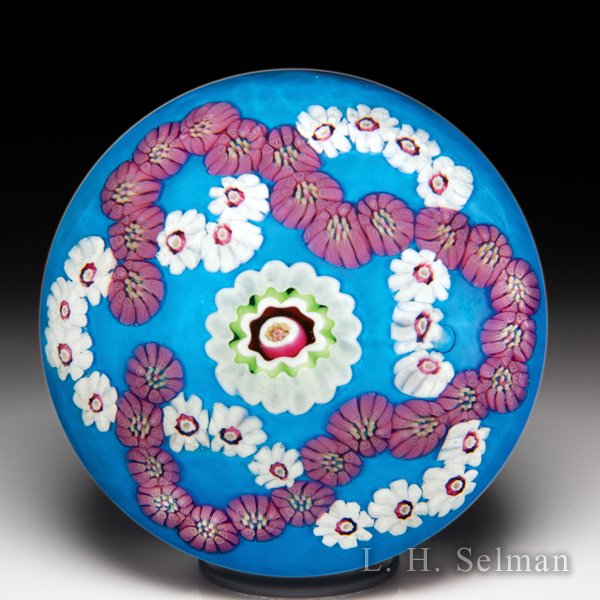Antique Clichy trefoil garlands on cerulean blue color ground glass paperweight. by  Clichy