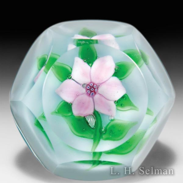 Ronald Hansen pink clematis faceted glass paperweight. by Ronald Hansen