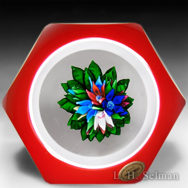 Saint Louis upright bouquet red and white faceted double overlay glass paperweight. by  Saint Louis