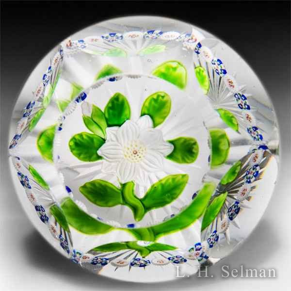 Antique Baccarat faceted white double clematis with bud and millefiori garland glass paperweight. by  Baccarat Antique