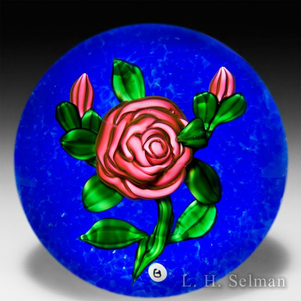 Ray Banford cabbage rose on blue ground paperweight. by Ray Banford