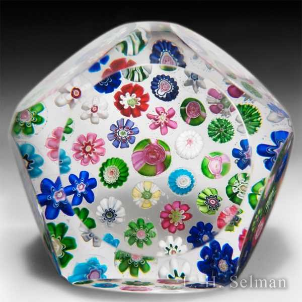 Antique Clichy scattered millefiori glass paperweight. by  Clichy