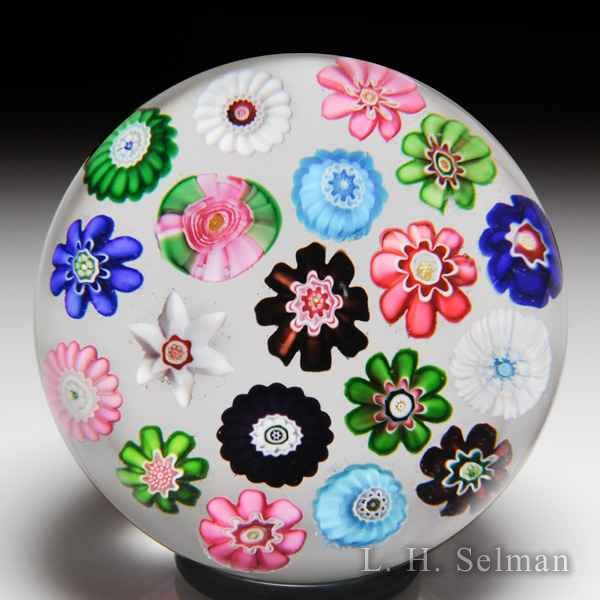 Antique Clichy spaced concentric millefiori with a pink rose glass paperweight by  Clichy