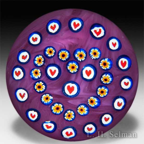 John Gentile heart canes and patterned millefiori on pink cushion ground paperweight. by John Gentile