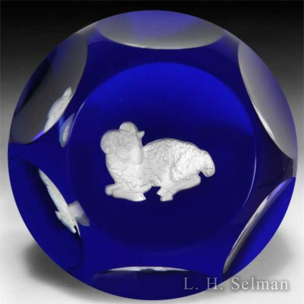 Baccarat Aries zodiac sulphide on translucent blue ground faceted glass paperweight. by Baccarat Moderns