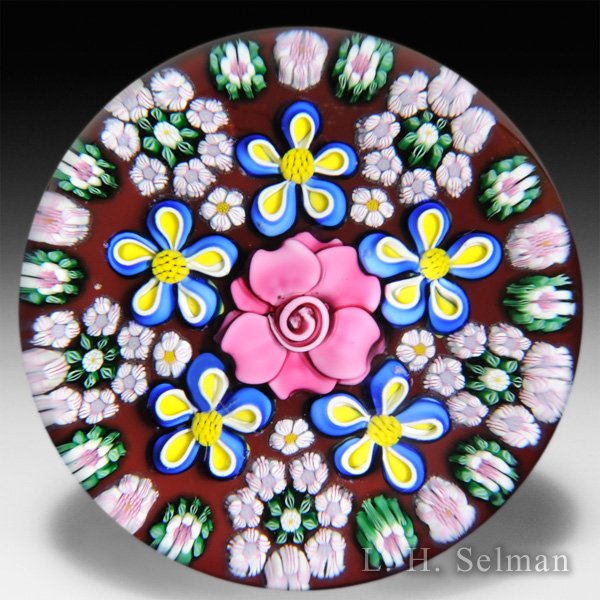 Sue Fox & Drew Ebelhare 2014 six flower on cranberry ground glass paperweight. by Drew Ebelhare & Sue Fox