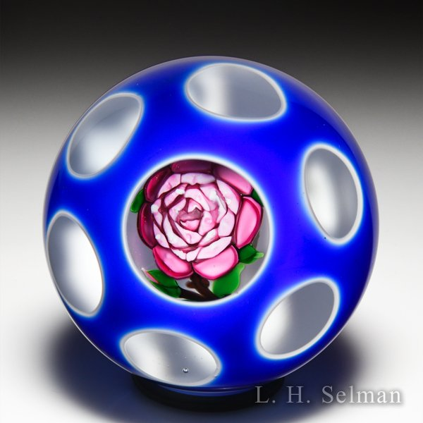 John Deacons pink rose in double encased blue-over-white overlay glass paperweight. by John Deacons