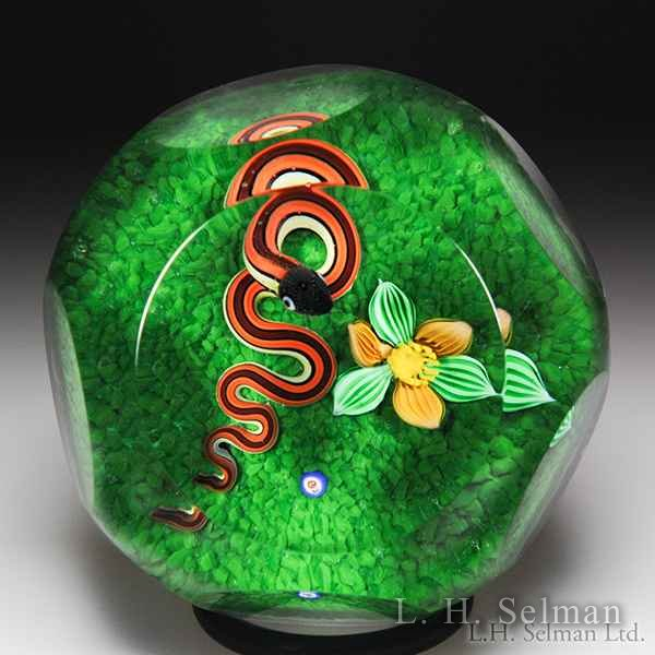 Bob Banford snake and flower faceted glass paperweight.  by Bob Banford