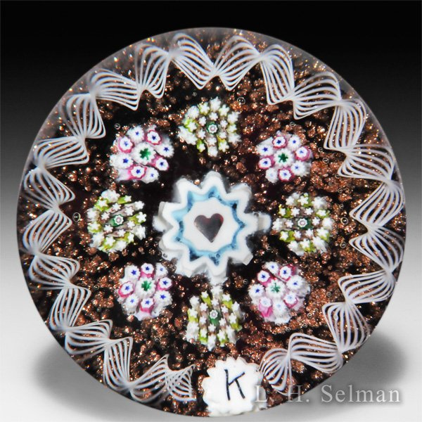 Charles Kaziun Junior spaced millefiori with heart miniature glass paperweight.  by Charles Kaziun Junior