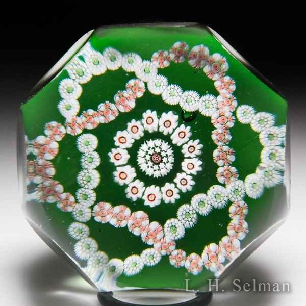 Antique Baccarat entwined double trefoil on translucent green ground faceted glass paperweight. by  Baccarat Antique