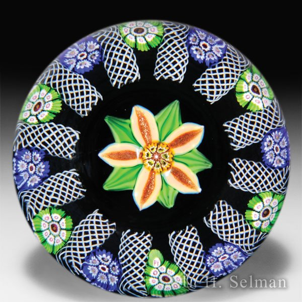 Paul Ysart salmon-colored flower on plum ground paperweight. by Paul Ysart