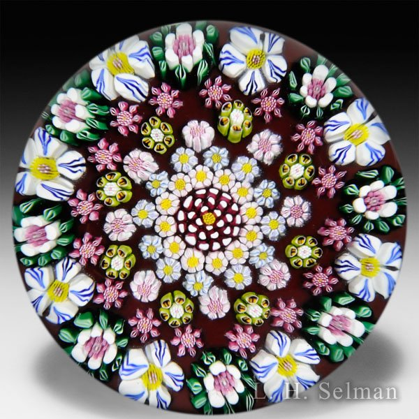 Drew Ebelhare 2015 patterned millefiori flower canes on ruby ground glass paperweight.  by Drew Ebelhare & Sue Fox