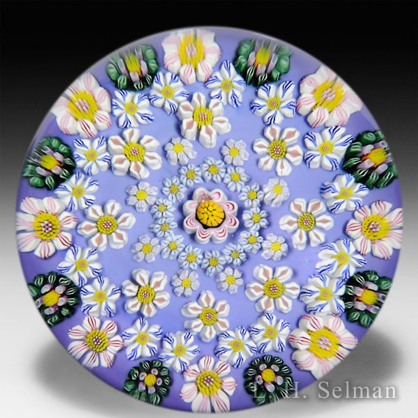 Drew Ebelhare 2015 patterned millefiori flower canes on teal blue ground glass paperweight.  by Drew Ebelhare & Sue Fox