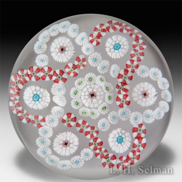 Antique Baccarat interlaced trefoil millefiori garlands glass paperweight. by  Baccarat Antique