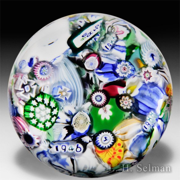 John Deacons (2016) end-of-day millefiori and twists glass paperweight. by John Deacons
