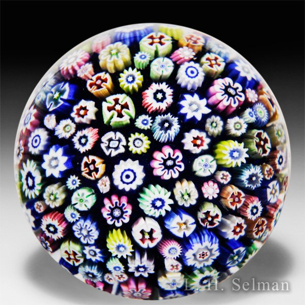 John Deacons (2016) close packed millefiori glass paperweight. by John Deacons