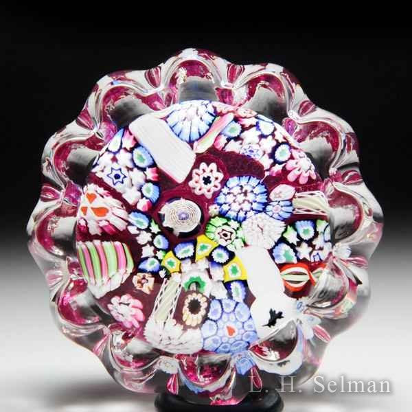 John Deacons (2016) pink end-of-day daisy-pressed paperweight. by John Deacons