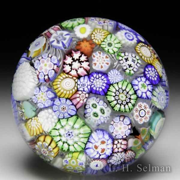 John Deacons (2016) close packed complex millefiori miniature glass paperweight. by John Deacons