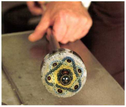 The Art of the Paperweight Lawrence H. Selman - Rolling latticinio into shape on marver