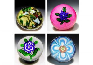 These four glass paperweights are indicative of the quality of about 400 paperweights currently at the Art Institute of Chicago that will be auctioned off to the public on Sept. 17. While some individual paperweights are expected to be worth five figures, bidding on groups of two to four begins at photo1,000.