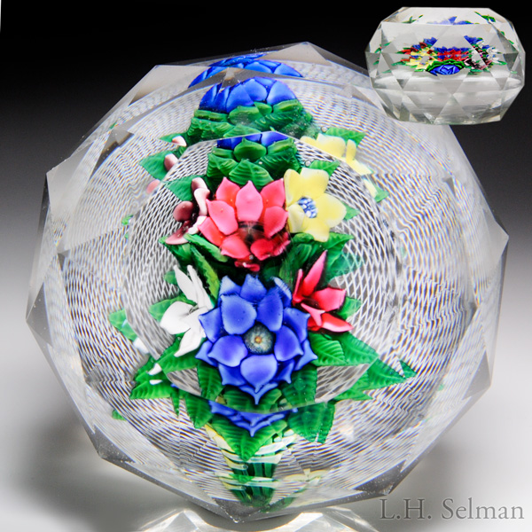 Extremely rare magnum antique New England Glass Company bouquet on latticinio faceted paperweight.