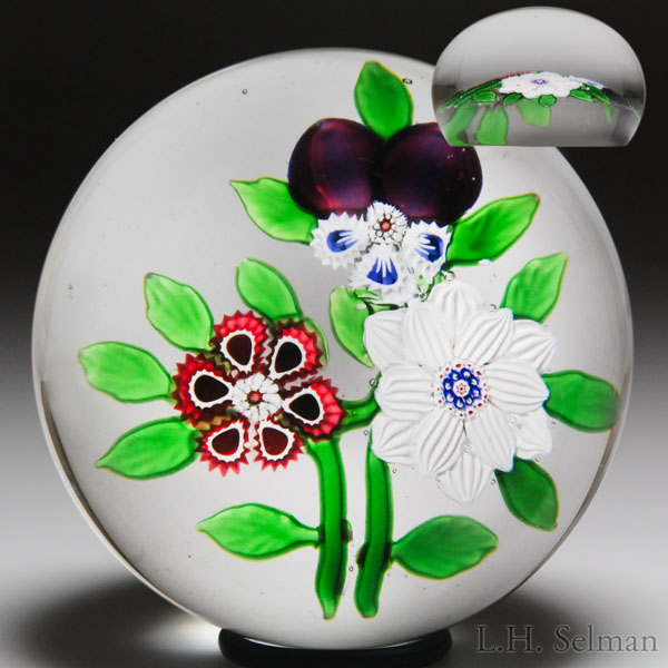 Rare antique Baccarat three-flower bouquet paperweight.