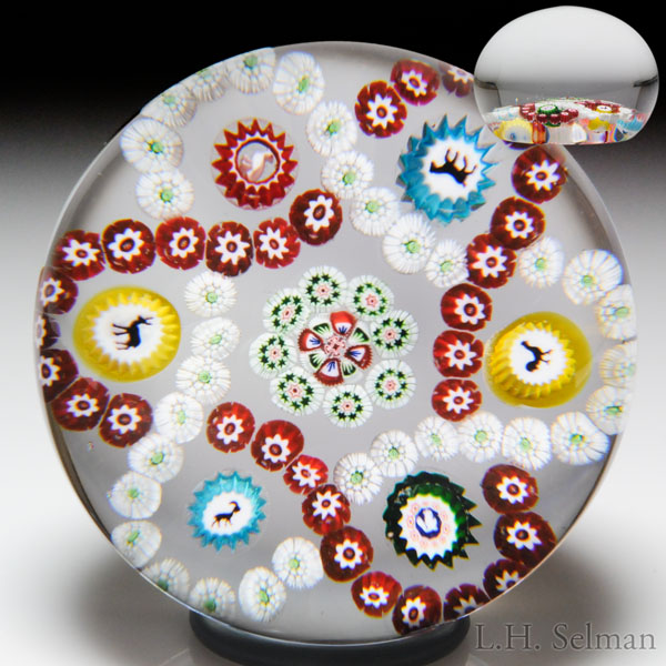 Antique Baccarat interlaced millefiori trefoil garlands with Gridel silhouettes paperweight.