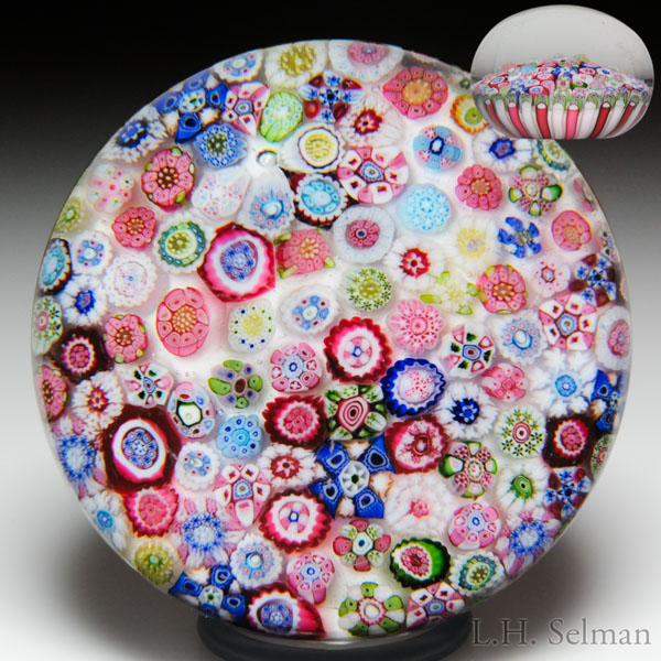 Rare antique Clichy close packed millefiori on sodden snow in stave basket paperweight.