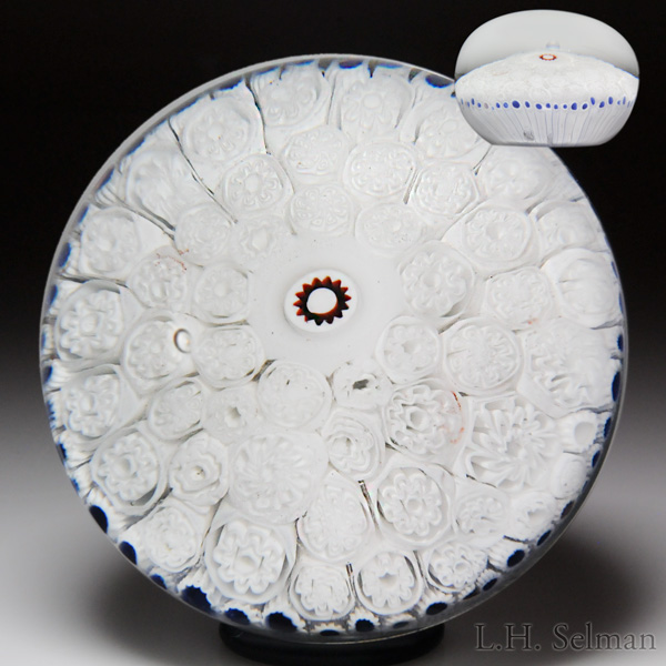 Antique Bacchus white millefiori carpet ground paperweight. Est. $6,000—8,000.