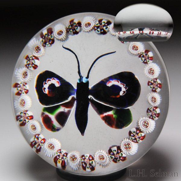 Antique Baccarat dark butterfly and millefiori garland paperweight. Est. $3,500—5,000.