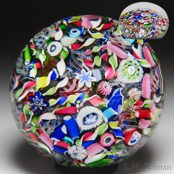 Antique Saint Louis end-of-day scrambled millefiori with uncommon silhouette paperweight. Est. $2,000—3,000.