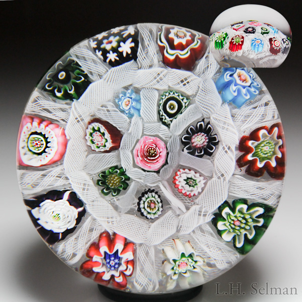 Antique Clichy very rare rose and millefiori chequer paperweight. Est. $2,000—3,000.