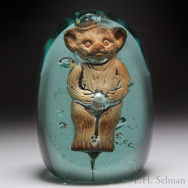 Extremely rare antique English terracotta teddy bear green bottle dump. Est. $700—1,000.