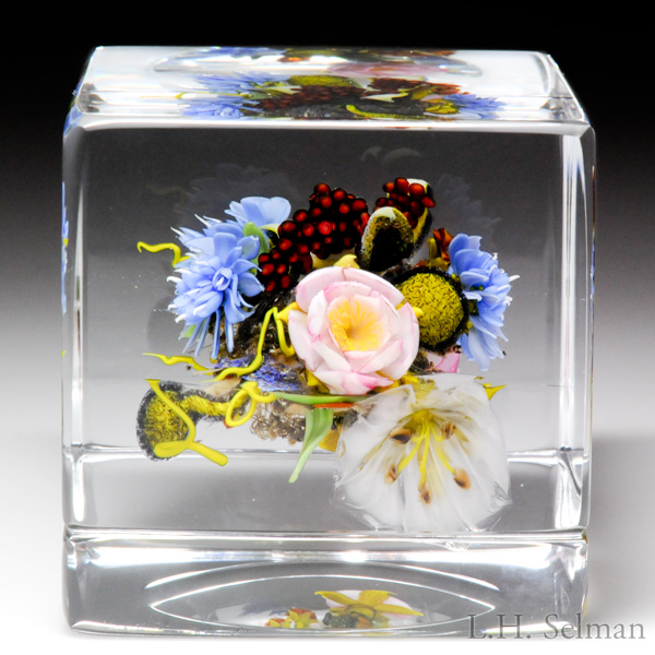 Paul Stankard 1997 flowers, pods, root people and word canes cube paperweight. Est. $3,000-4,000.