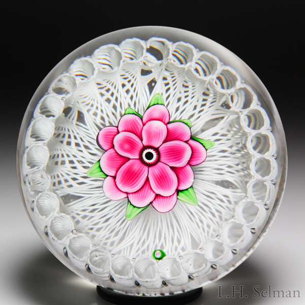 Paul Ysart three-tiered pink flower in a white latticinio stave basket paperweight. Est. $500—700.