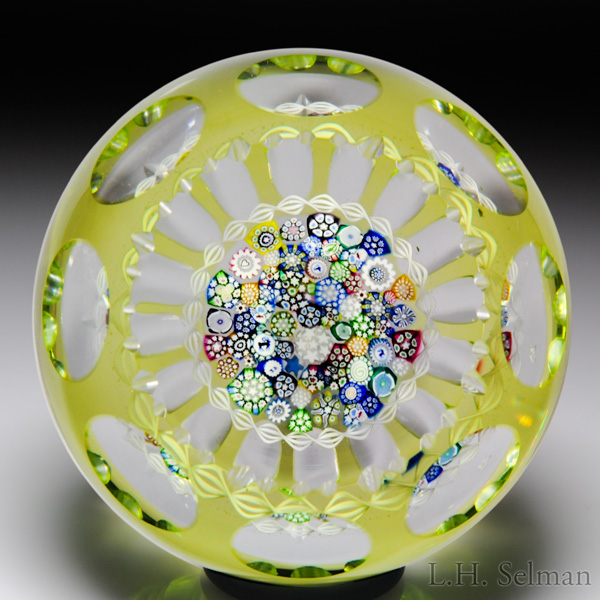 John Deacons close packed millefiori overlay faceted paperweight. Est. $500—700.