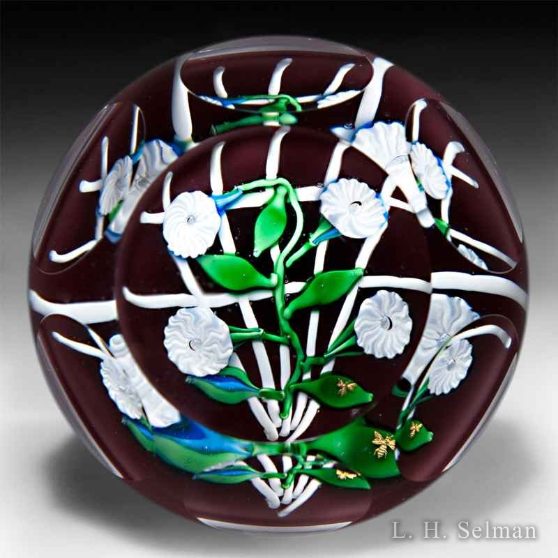 Charles Kaziun Jr four white convolvuli on white trellis glass paperweight. by Charles Kaziun III