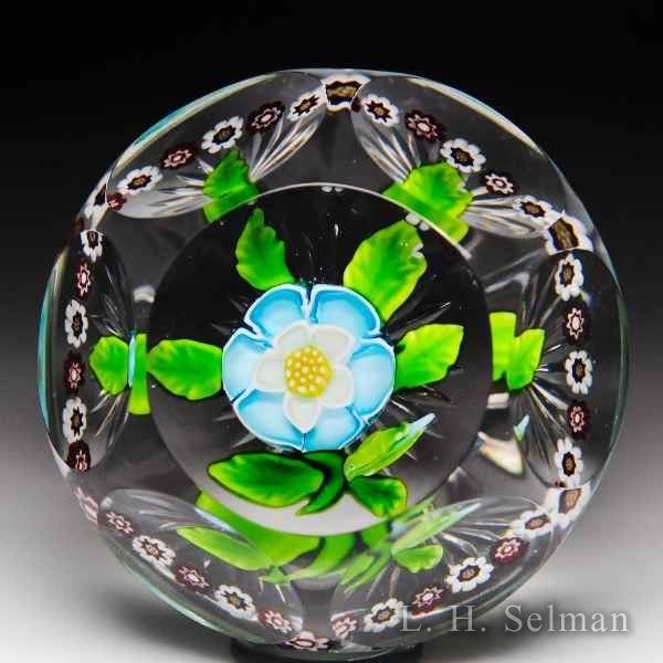 Antique Baccarat faceted blue & white buttercup with garland glass glass paperweight. by  Baccarat Antique