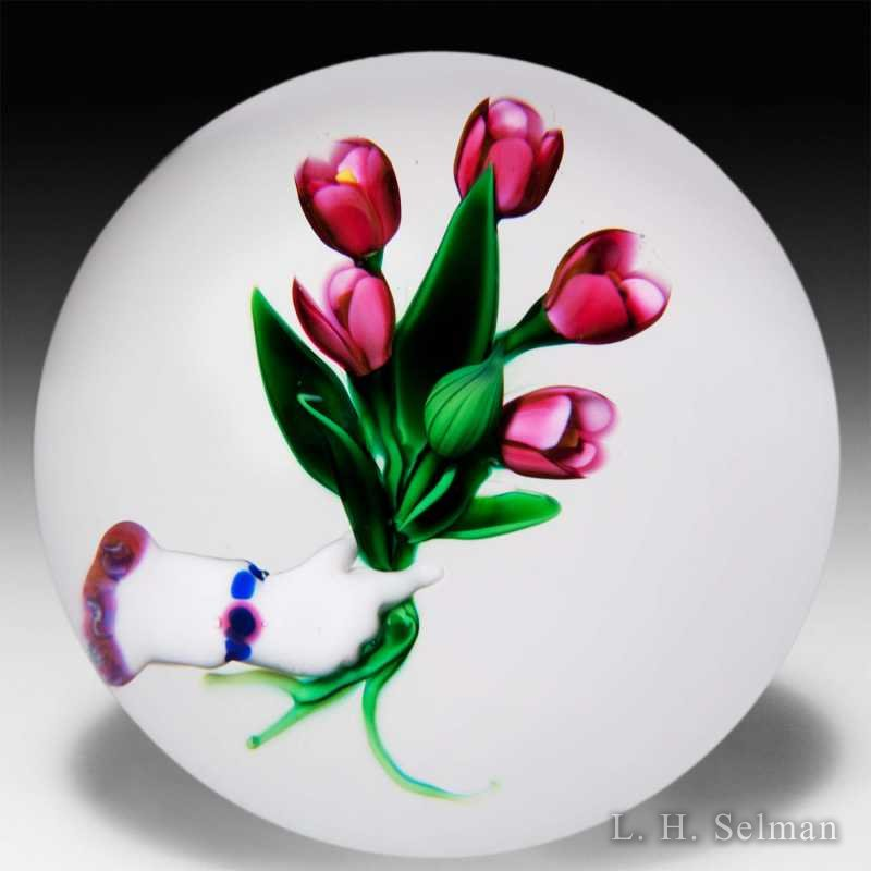 Debbie Tarsitano bouquet and gloved hand glass paperweight. by Debbie Tarsitano