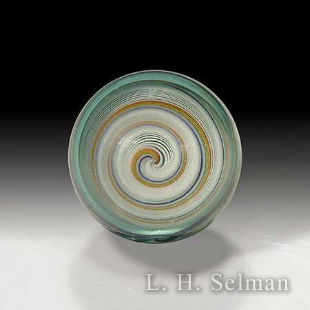 Kevin Leopold Spiral small marble, with a white and orange spiral design on the interior. by Kevin Leopold