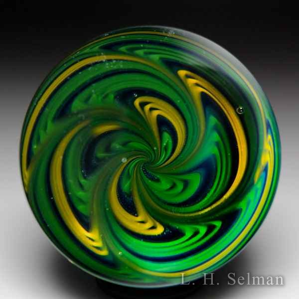 Leopold 'Spiral' medium marble in green & yellow on blue by Kevin Leopold