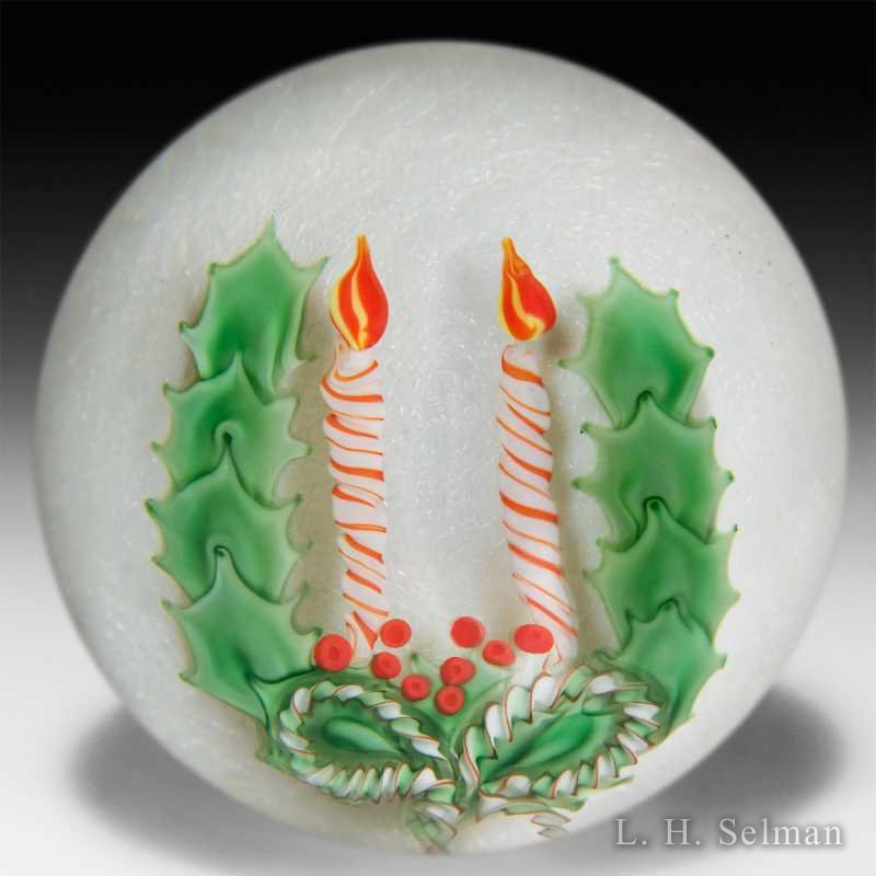 Orient & Flume 1990 two candles & holly on iridescent white glass paperweight. by  Orient & Flume