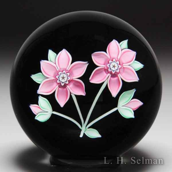 Peter McDougall 2008 pink flowers on black ground glass paperweight. by Peter McDougall
