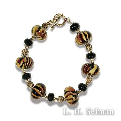 Wasserman 'Tiger Print' brace- let in amber, brown & black by Ann Wasserman